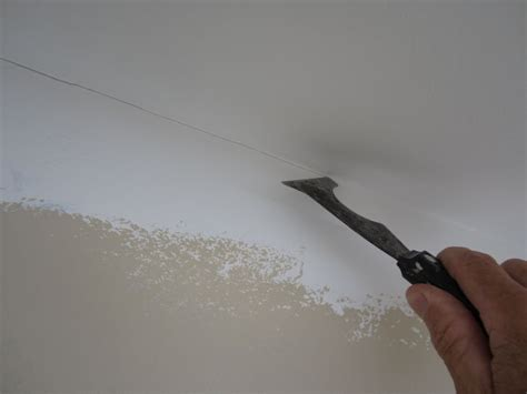 painting a straight line at the ceiling trick hometalk