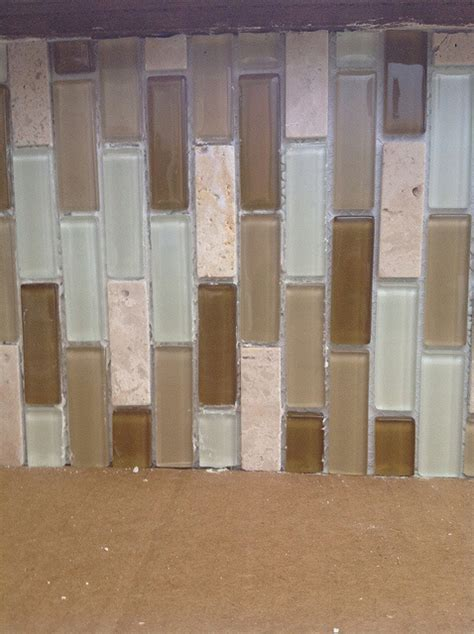 how to tile a glass mosaic backsplash paneling the