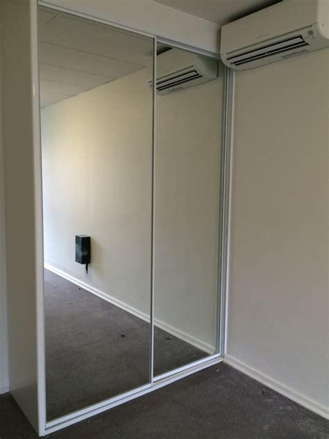wardrobe vs armoire mirror sliding wardrobe door with white frame saudireiki
