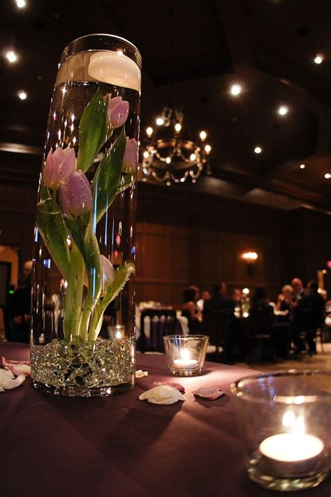 wedding centerpieces with candles and water pink tulips submerged in water wedding centerpiece