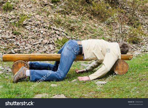 fucking on park bench young man deeply sleeping drunk laying stock photo