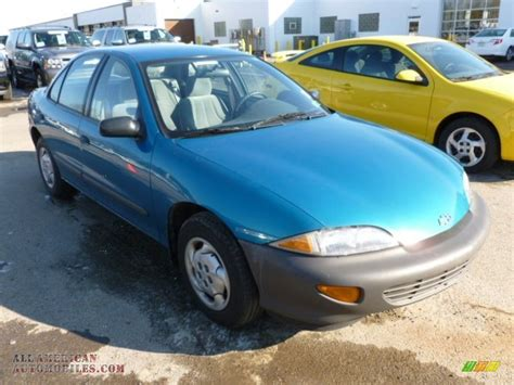 teal blue car 1995 chevrolet cavalier sedan in teal blue metallic photo
