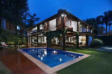 building a pool house pool of house with wooden elements and beautiful garden