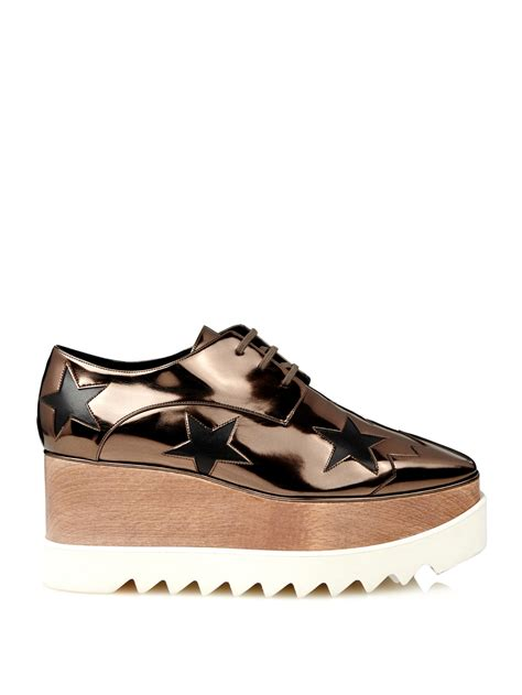 stella mccartney sneakers lyst stella mccartney elyse metallic lace up platform