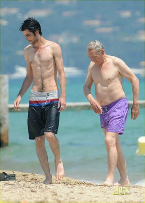 ian mckellen at the beach with a boy. a very very very