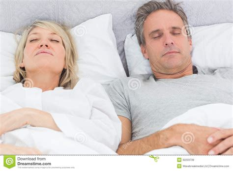 in their bedroom couple sleeping in their bed royalty free stock images image 32233739