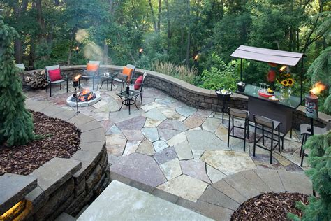 building a paver patio on a hill landscaping transforms steep slope in apple valley mn