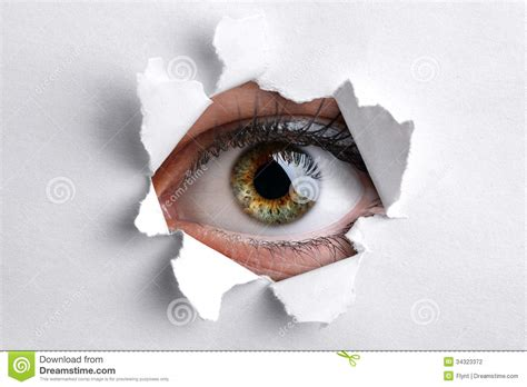 How To Make A Paper Eye - looking through a in white paper stock photo image