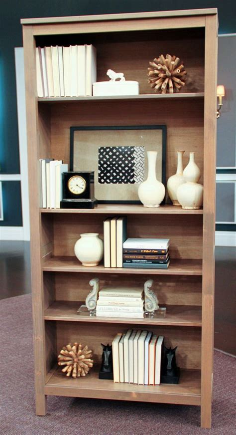 how to decorate a bookshelf how to style a bookcase steven and chris