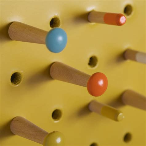 white pegboard with wooden pegs small by block design yellow pegboard with wooden pegs medium by block design