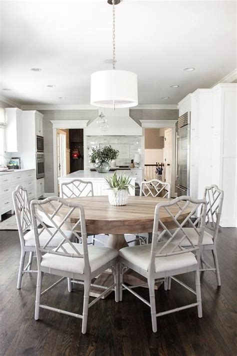 White And Wood Kitchen Table by Open Plan Dining Room Located Beside A Large Kitchen