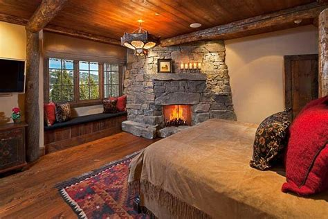 cabin bedroom log cabin bedroom with a stone fireplace yes please