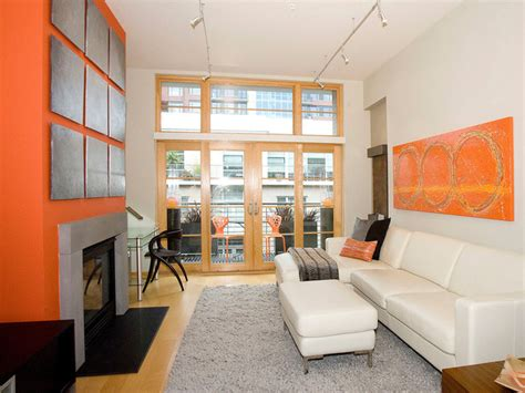 orange accent wall living room contemporary living room with orange fireplace and decor hgtv