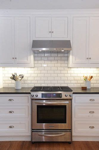 gray ikea kitchen cabinets with white beveled subway tile beveled subway tile with grey grout the bee keepers