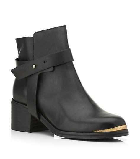 carvela boots for carvela kurt geiger ankle boot in black gold lyst