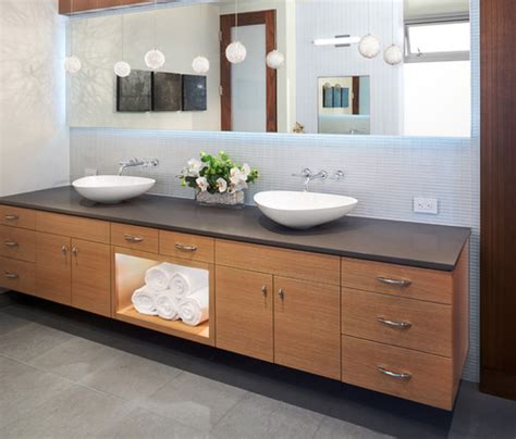 Captivating contemporary bathroom design with floating white wash basin among twin stainless