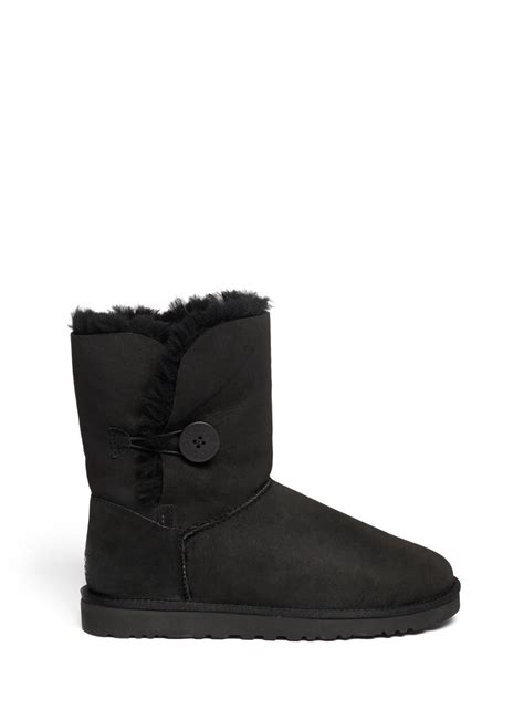 ugg boots for black ugg bailey button boots in black lyst