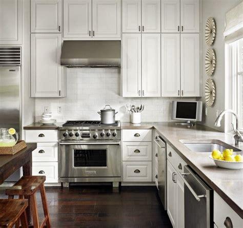 white kitchen cabinets, glossy white beveled subway tiles
