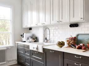 pictures of kitchens with white cabinets and black countertops black and white kitchen transitional kitchen stadshem