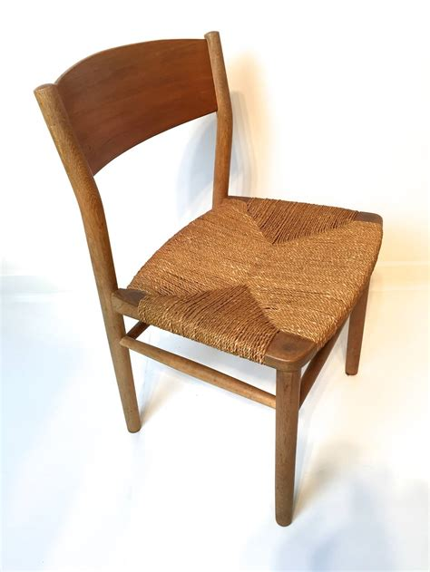woven dining room chairs seagrass chairs modern rectangular dining table with glass