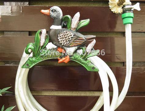 cast iron hose holder  garden  cottage wall mounted