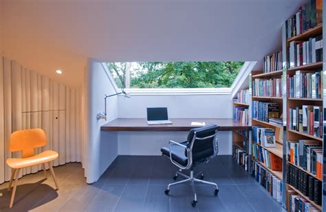 writing room para project converts attic into shared writing room