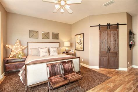 country master bedroom with ceiling fan hardwood floors