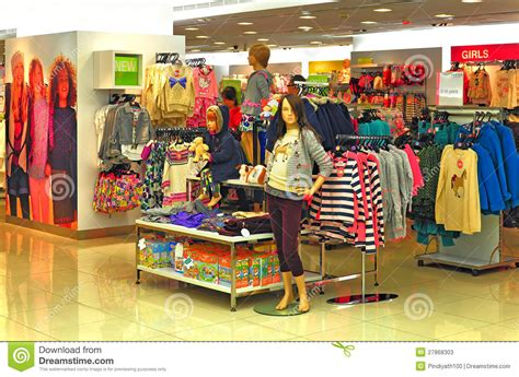 childrens winter clothing store editorial stock photo