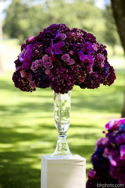 hues of purple wow various hues of purple in this tall centerpiece are