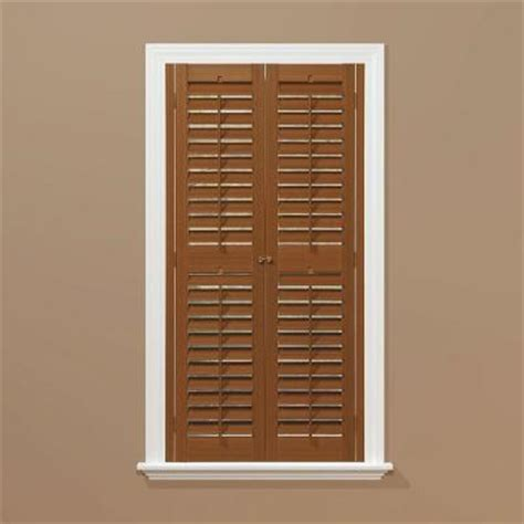 homebasics plantation faux wood oak interior shutter price varies by size qspb3560 the home
