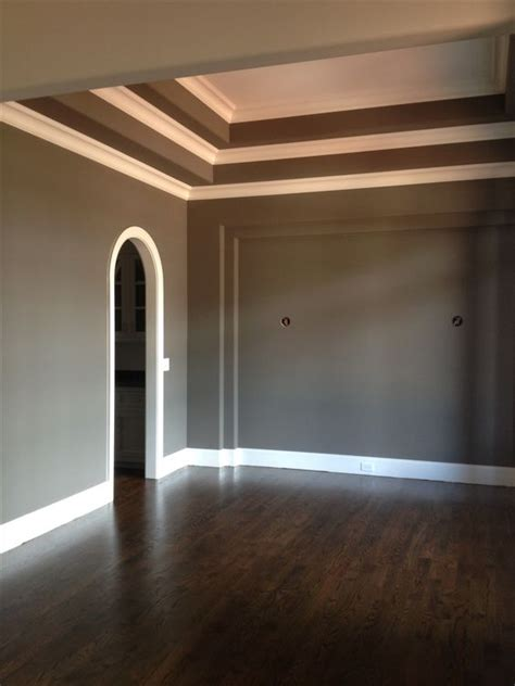 sherwin williams gauntlet gray walls with white trim and jacobean stained oak floors