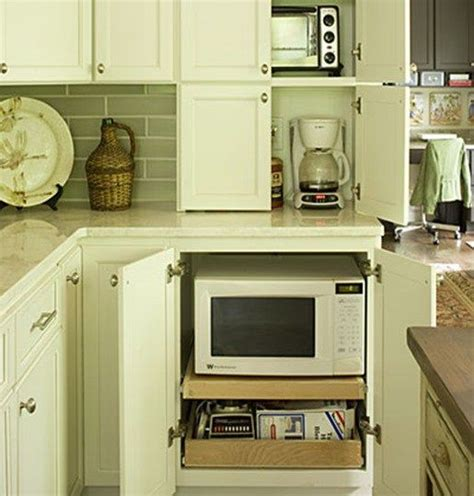 microwave hideaway cabinet for the home pinterest 25 best ideas about hidden microwave on pinterest