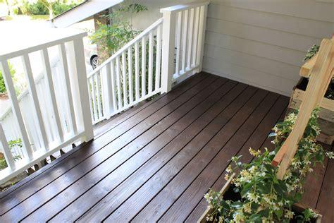 deck color behr semi padre brown behr solid white railings deck
