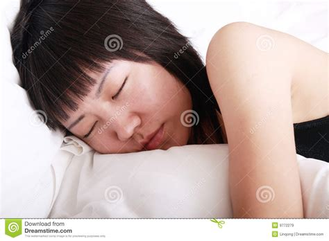 sleeping in asia asia girl sleeping on bed royalty free stock images