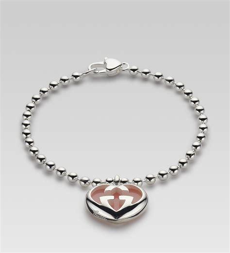 gucci bracelet with heartshaped interlocking g motif