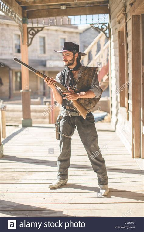 film cowboy in italiano portrait of cowboy holding up shotgun on wild west film