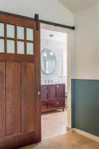 shower barn door floor to ceiling tile creates serene master bathroom
