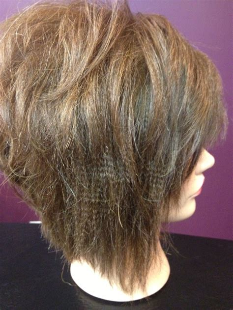 diagonal forward haircut for curly hair textured flat iron style and stacked diagonal forward