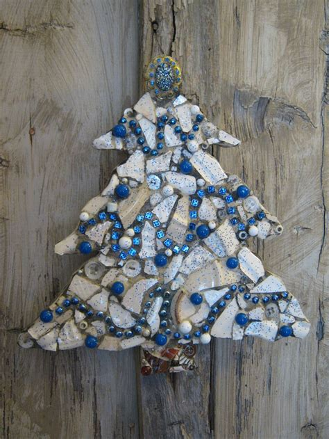 blue and white mosaic christmas tree with vintage brooch