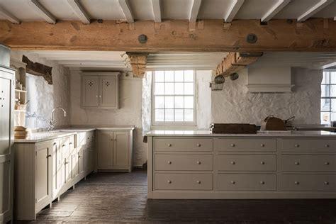 mushroom color cabinets silestone counters island storage idea beams dark floor covered hood kitchens pinterest