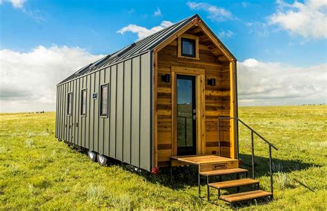 tiny tumbleweed this tiny farm house on wheels starts at 63k downstairs bedroom inhabitat green design