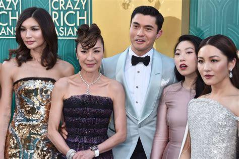 crazy rich asians cast  unfairly criticized   wearing asian designers vox