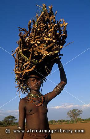 photos and pictures of: dasanesh woman carrying fire wood