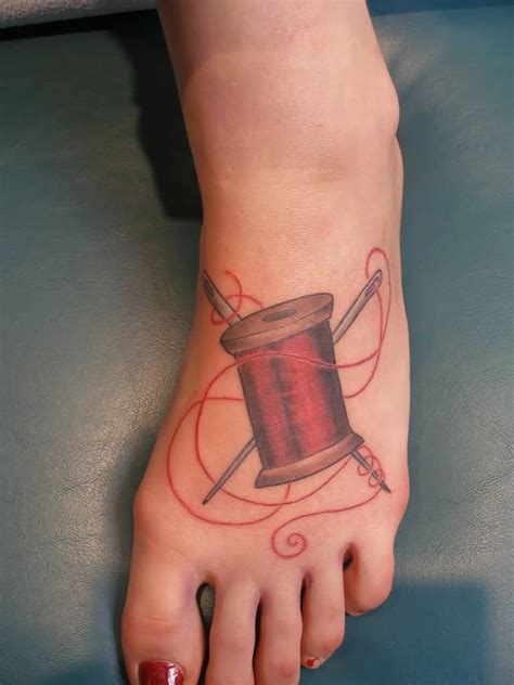 needle and thread tattoo spool thread with needle on foot