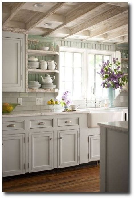 bhg cottage kitchen with seafoam green painted beadboard walls white kitchen cabinets