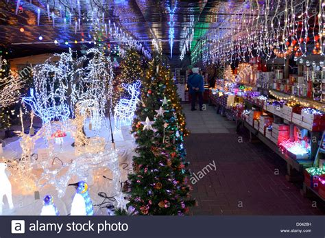display of illuminated christmas decorations on sale in a