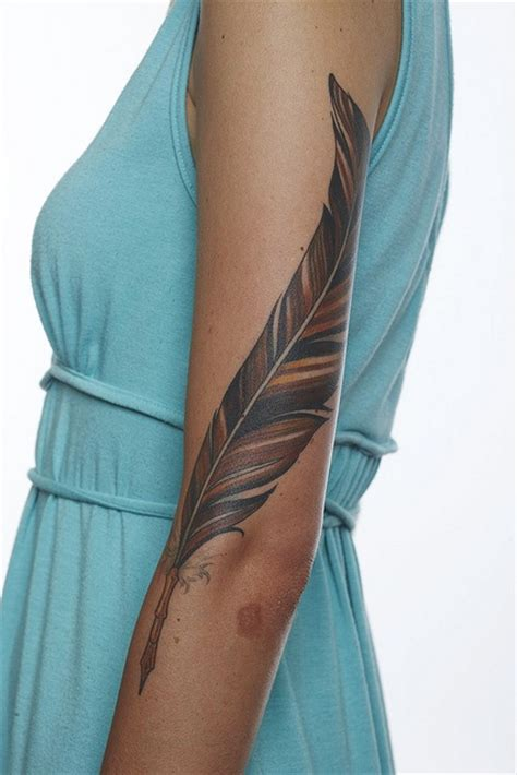 feather tattoo on girl s arm 29 arm tattoos designs for women