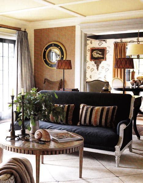 navy blue and chocolate brown living room blue velvet sofa transitional living room porter design company