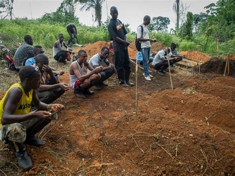 the difficulty of burying ebolas victims smart news smithsonian doctors battling ebola are met with fear mistrust abc news