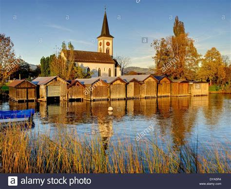 boat houses and a church in autumn on lake zurich http - Boat House Zurich